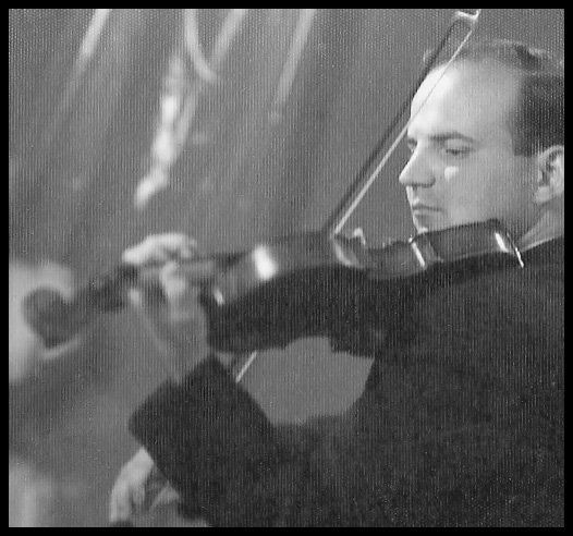 Constantinides playing violin in Greece
