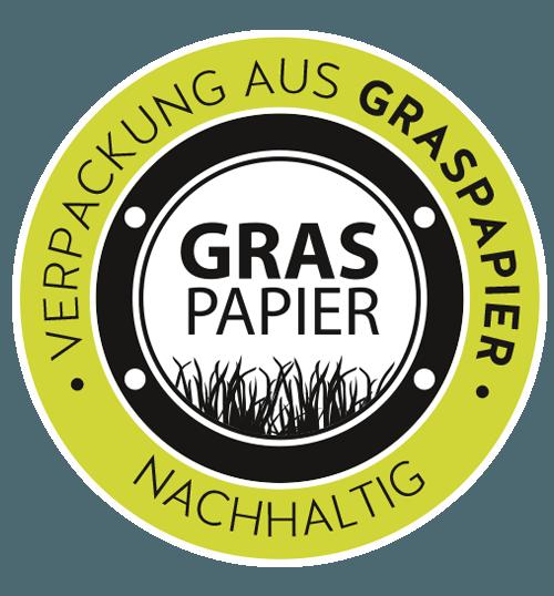 Button mit Aufschrift Verpackung aus Graspapier