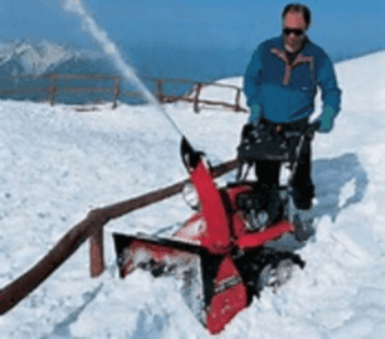 Snow clearance with snow thrower machine