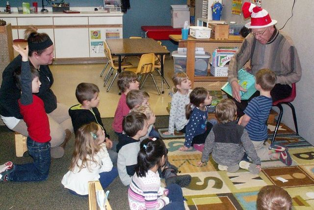 Reading to children on Dr. Seuss day.